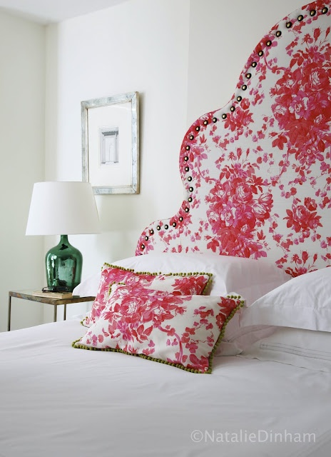 headboard and pillows in bennison roses in lipstick pink