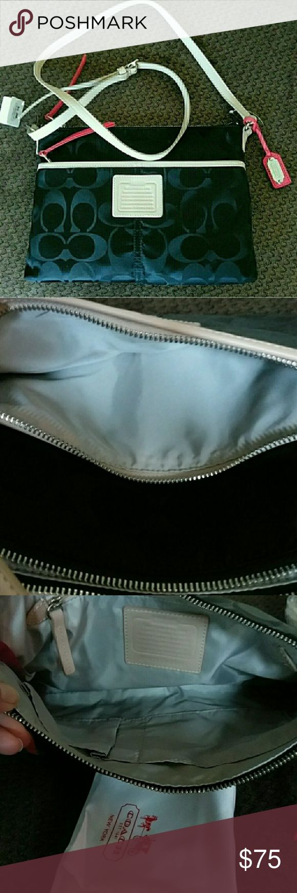 """Coach Legacy Weekend Signature Hippie Coach Legacy Weekend Signature Hippie NWT Black Nylon comes with dust bag.  11""""L x8""""H x1"""" new never used perfect condition retails for $148 Coach Bags"""