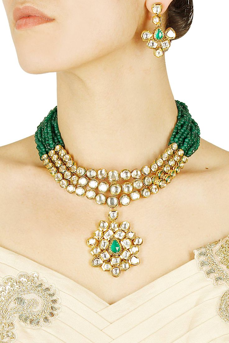 Gold finish kundan studded necklace with green stone earrings available only at Pernia's Pop Up Shop.
