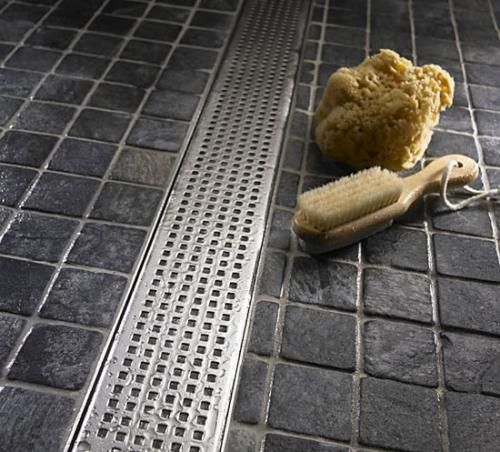 linear shower drain allows you to use larger tiles in the floor of the shower. Got it!