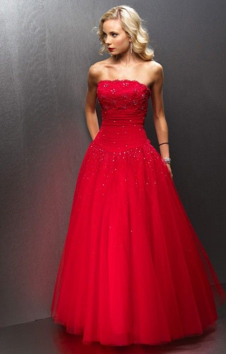 If we were to see Kim Kardashian at prom this year, chances are she may be wearing something much like this Alyce Paris 6564! It is sensual yet still sophisticated. This drop waist ball gown has the ability to give the wearer a mysterious appeal. The skir tis made of multiple layers of tulle. The fitted bodice is strapless and has a neckline that is decorated in a lace design. A zipper closure can be found in the back. Lace fabric overlays the bust, while cinched chiffon defines the…