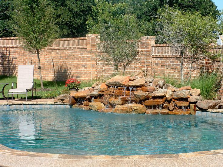 8 best pool waterfall ideas images on pinterest pool for Natural rock swimming pools