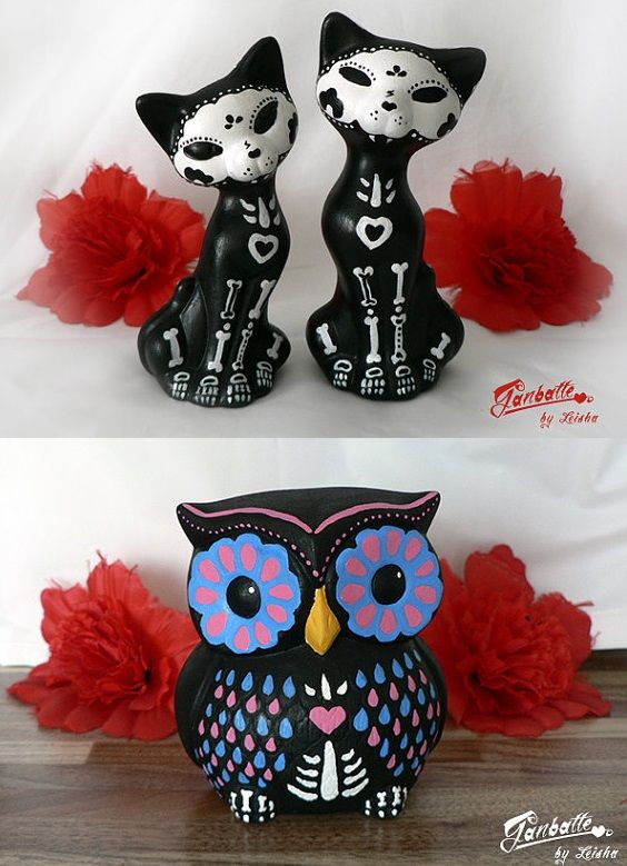 Sugar skull owl and cat sculptures