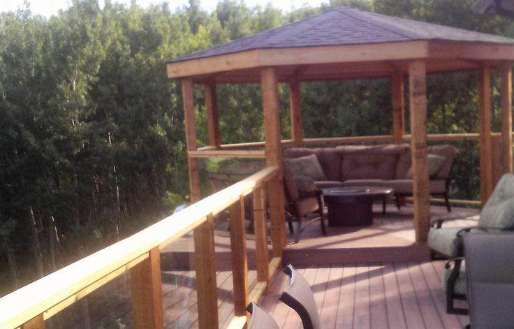CREATE ESCAPE - Artesia.  Fibron Horizon decking with a custom cedar and glass deck railing.