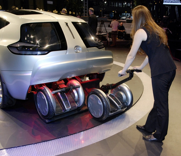 Opel Flextreme Concept Car - The Segway PT units attach to a docking station inside the cargo space where they recharge while the Flextreme batteries charge.
