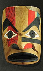 Nootka people, W Vancouver Island, Canada 10 1/2 inches, old-growth red cedar, copper  Carved by Ernie Chester and described as a Nootka Transformation Mask, however, it is actually a canoe mask. Year unknown. The lower lip has been broken off and professionally repaired. This is a style of mask that is meant to be viewed from either side.