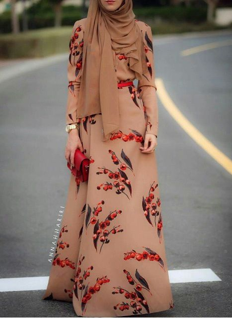 This is a muslim. I still belive this outfit is very astonishing and perfect for parties. I also respect the idea of wearing the hijab with this stunning floral dress.