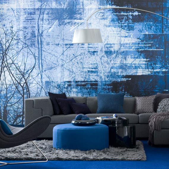 The Monochromatic living space has one dominant color blue with different shades. The pillows on the couch provide a deeper shade of blue while the carpet is a brighter shade. This gives the room some variety.