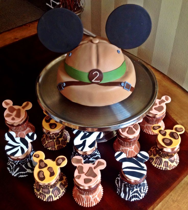 Too Sweeties a bake Shoppe.. Mickey Mouse Safari birthday cake and cupcakes.