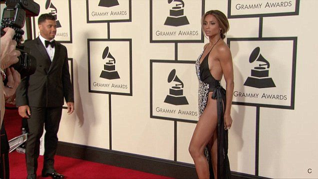 Ciara stuns all flashes flesh on the red carpet at the 2016 Grammy Awards. Ciara was joined by boyfriend Russell Wilson who looked dapper in suit.
