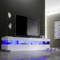Liven LCD TV Stand In White High Gloss With LED Lighting will look simply great in your living room. Finish: White High Gloss And Grey Glass Features: •Liven LCD TV Stand In White High Gloss W...