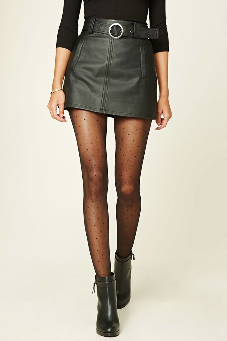 A pair of sheer tights featuring a polka dot print and an elasticized waist.