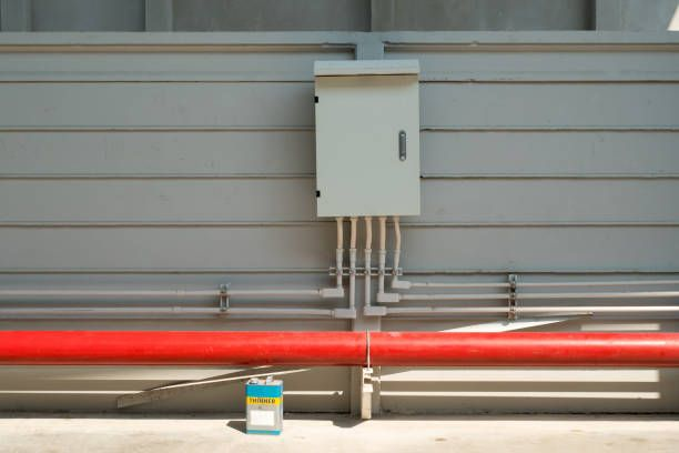 red fire water pipeline and a control box