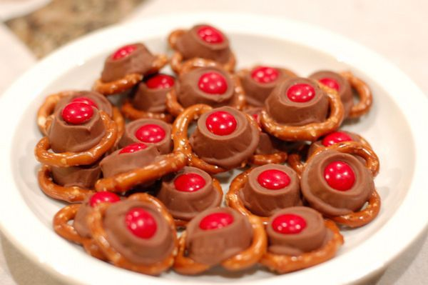 These easy Rudolph noses are made from pretzels, Rolos, and red M&Ms. | 41 Adorable Food Decorating Ideas For The Holidays
