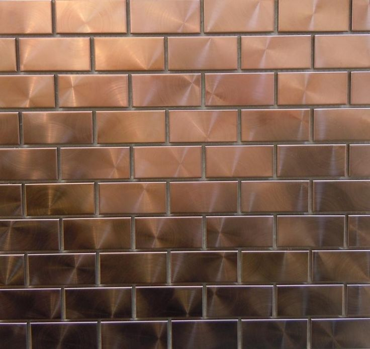 "Modern twist with 1"" x 2"" copper tiles.  Can you say bar backsplash??"
