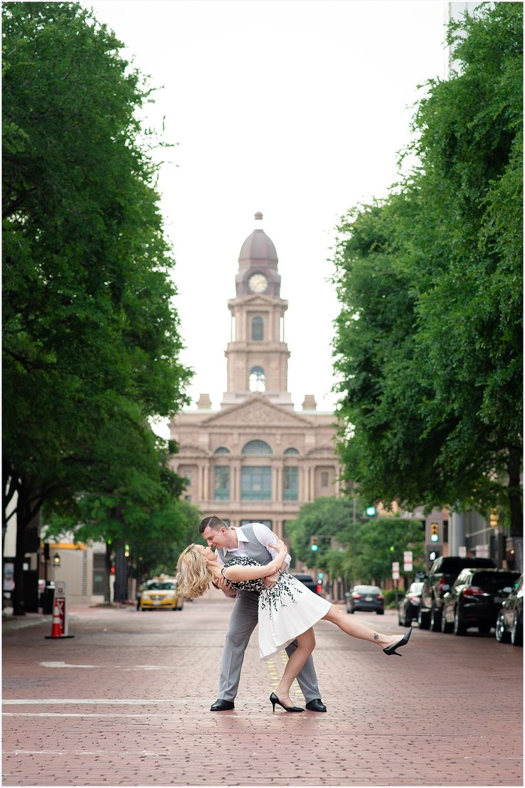 Sundance Square Fort Worth engagement session. Couple dancing in the street, courthouse in the background.  Fort Worth wedding photographer Vanja D Photography www.vanjad.com