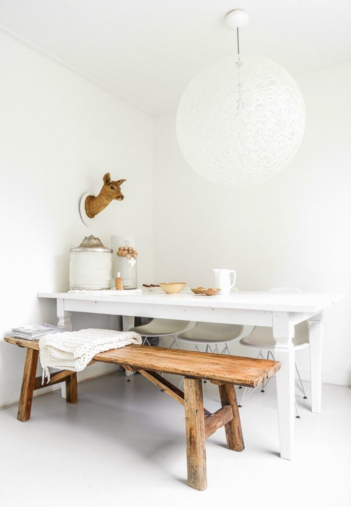Beautiful painted white table, and great use of a bench.