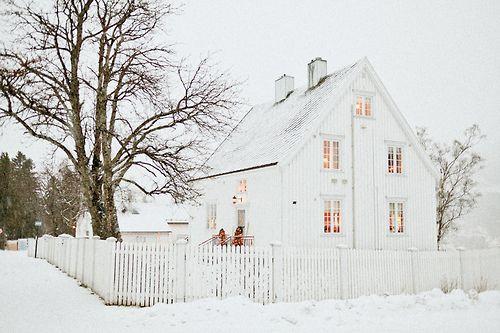 white farmhouse in the snow