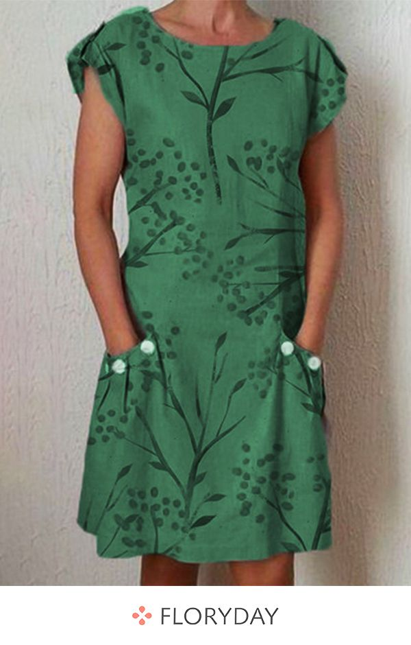Knee-length shift dress with cap sleeves and front pockets