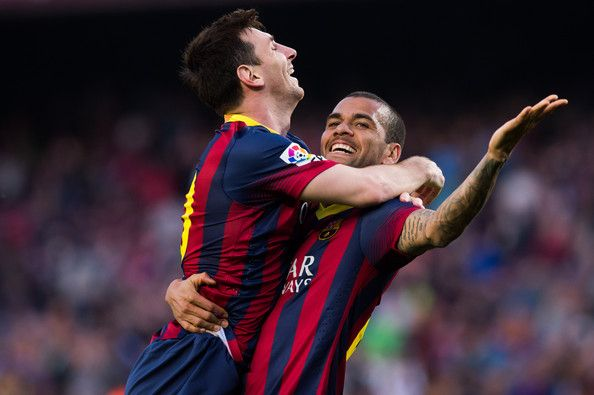 Lionel Messi of FC Barcelona celebrates with his teammate Daniel Alves after scoring his team's sixth goal during the La Liga match between FC Barcelona and CA Osasuna at Camp Nou on March 16, 2014 in Barcelona, Catalonia.