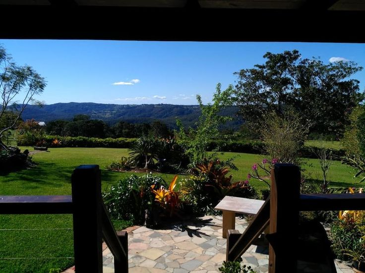 """House in Reesville, Australia. Only a 5-10 min drive from Maleny, """"Cethor"""" is a lovely semi-rural retreat overlooking the Curramore Range.  Set in 2 acres of beautiful gardens and sprawling lawns, our 3 bedroom property is great for couples or families. You'll love the views an..."""