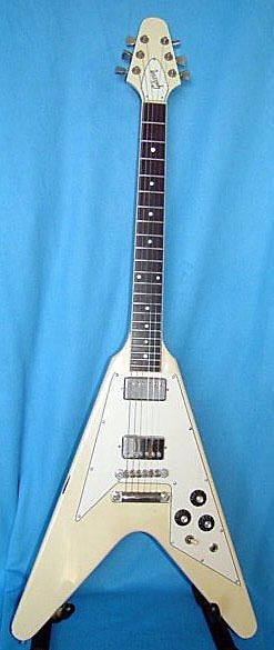 "1981 Gibson Flying V - White - Rare WIDE NUT ModelVintage Flying V with super rare Les Paul type nut width of 1 11/16"". Almost all 1970s and 1980s Flying V guitars with pick guards are small nut width guitars at 1 9/16"". Gibson began using smaller nut widths on most all of their guitars in 1965 with the exception of the reissue Les Paul guitars starting in 1968. That makes this Flying V very desirable to players wanting the full nut width.This Flying V has had a headstock repair and touchup…"