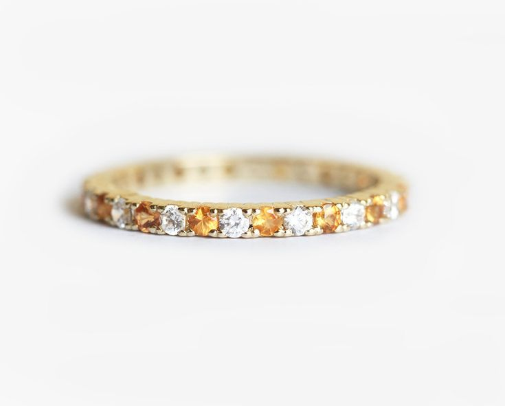 Full eternity wedding ring with 2 mm diamonds and orange - golden sapphires. Price is for orange sapphire and diamond ring. Perfect for stacking with your engagement ring. This eternity ring can be made with other gemstones: - amethyst  - turquoise  - pearl  - ruby  - emerald  - blue