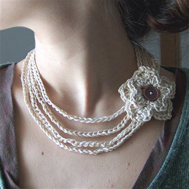 I already have two of these, and I love the crochet flower.  Crochet Necklace by creativeyarn
