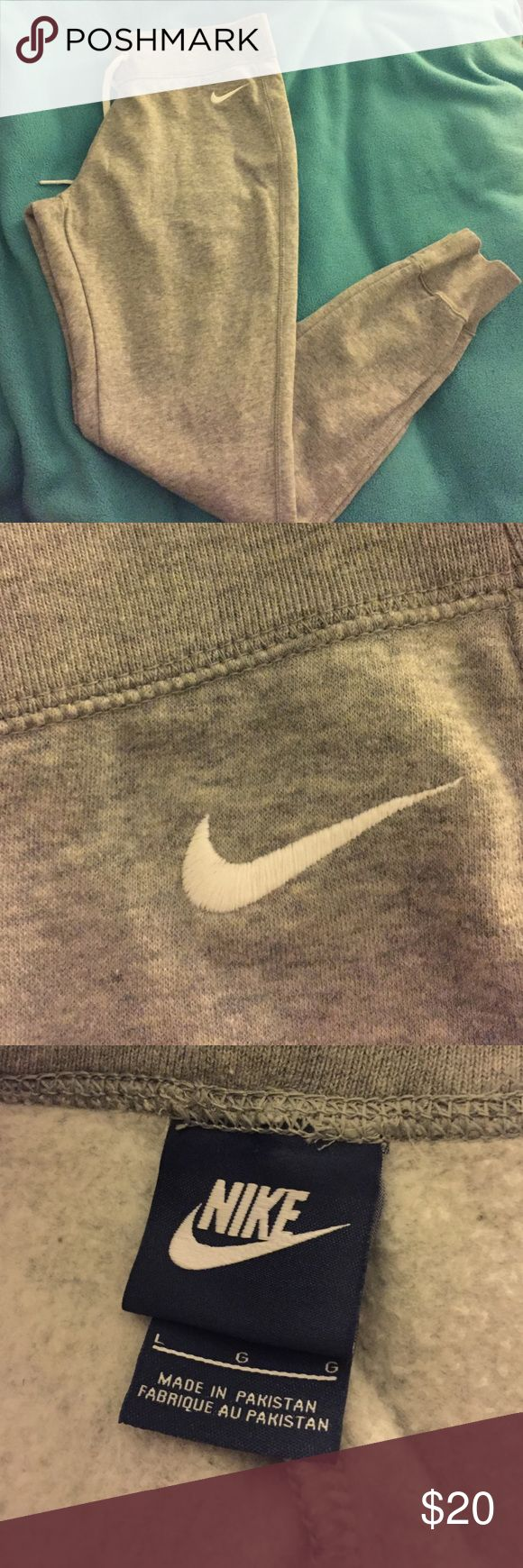 Nike slim fit Jogger sweats Grey Nike slim fit Jogger sweats, never worn just tried on, perfect condition, can fit S-L depending on how you want them to fit, Nike Pants Track Pants & Joggers