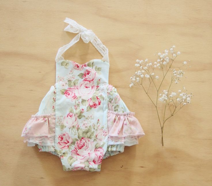 This gorgeous vintage style play suit is super cute with loads of ruffles and lace.- Beautiful flora fabric -made with 100% cotton-Elastic back-Snap buttons for essay nappy changes.-Ruffles-Made in AustraliaCustom order available from size newborn to 2 years.