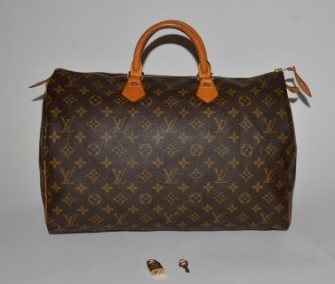 Authentic Louis Vuitton Monogram canvas Speedy 40 with the original lock and keys.   Monogram canvas is without marks or wear. Cowhide handles are firm with darkening, light marks and light scratches. Cowhide piping surrounding the edge is with small amount of very light abrasion and light darkening. Lining is without marks or wear. Cowhide zipper pull has a rip. Zipper works perfectly.   Date code:  SP1912    10 (height) x 15.75 (width) x 7.5 (depth)   Measurements are taken carefully and…