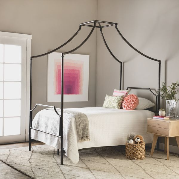 Outfit a child's bedroom or guest room with this Bailey twin metal canopy bed and add a touch of classic beauty to your home. The charcoal-colored powder-coated finish on this twin metal bed resists s