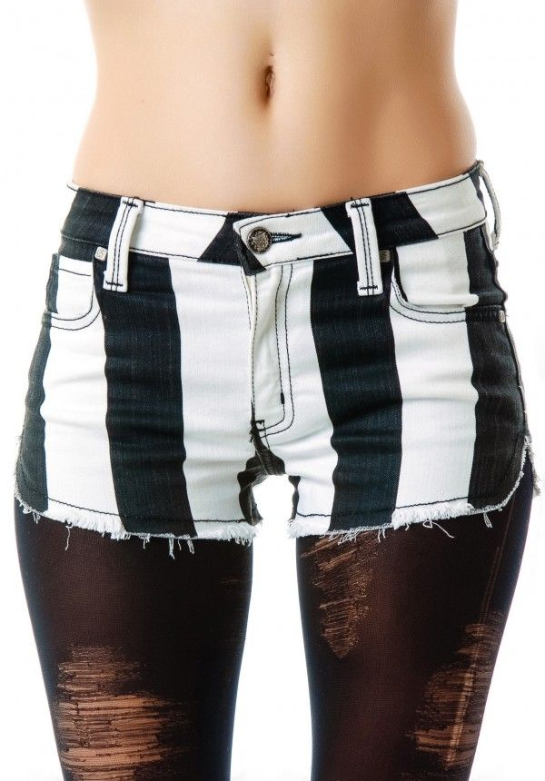 Black and white striped shorts with distressed tights. Something I would definitely wear.