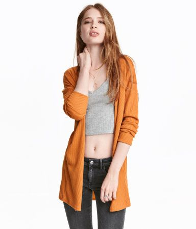 Dark mustard yellow. Cardigan in a soft, fine rib knit with long sleeves and no…