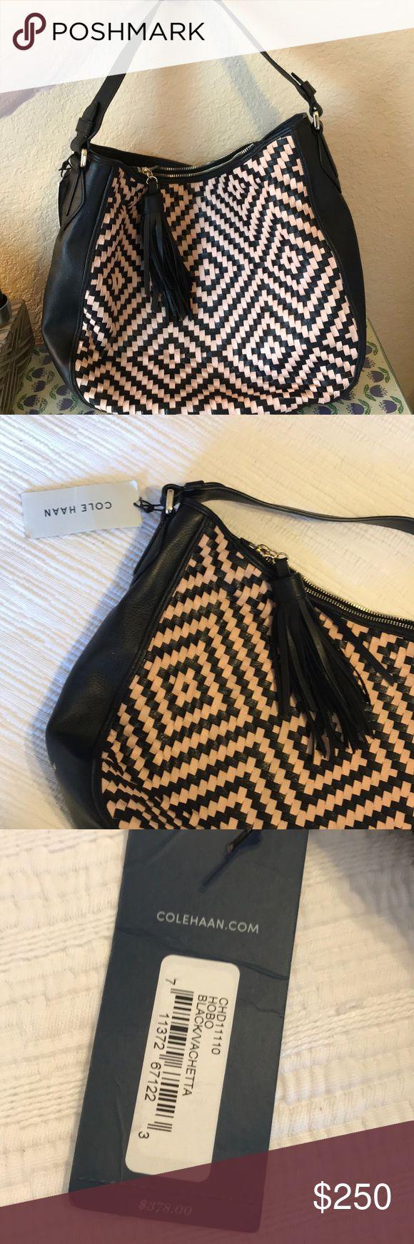 Cole Haan Black/Tan Hobo with Tassel Brand new with tags. Cole haan Black and Tan leather hobo purse with tassel on zipper Cole Haan Bags Hobos