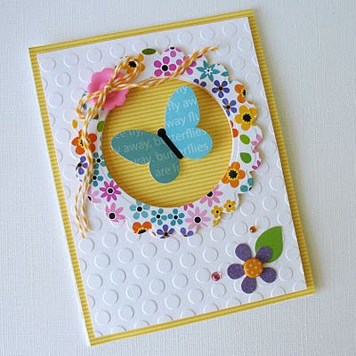 Cuttlebug butterfly card. Made with a circle punch but you could use a circle cutter and then go over the edge with decorative edge scissors.