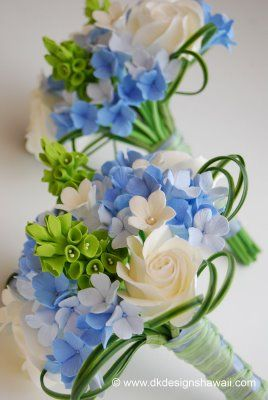 Blue hydrangeas, bells of Ireland and white roses.