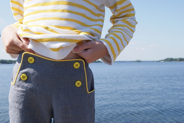 Make Oliver+S sailboat pants with colored piping.  Navy + a subtle color, fabric covered buttons.
