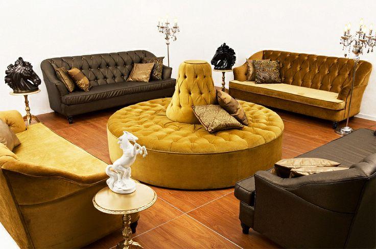 Gold Deep Button Ottoman as a center piece. Lounge Pod