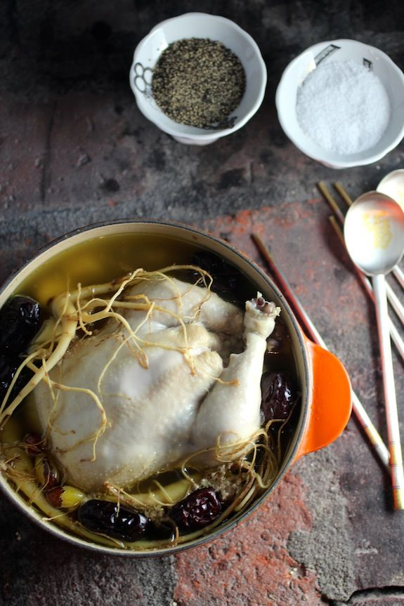 Samgyetang 삼계탕 A Rejuvenating Korean Soup Whole Chicken Stuffed with Sweet Rice, Pine Nuts, and Garlic  In a Broth Simmered with Ginseng, Gi...