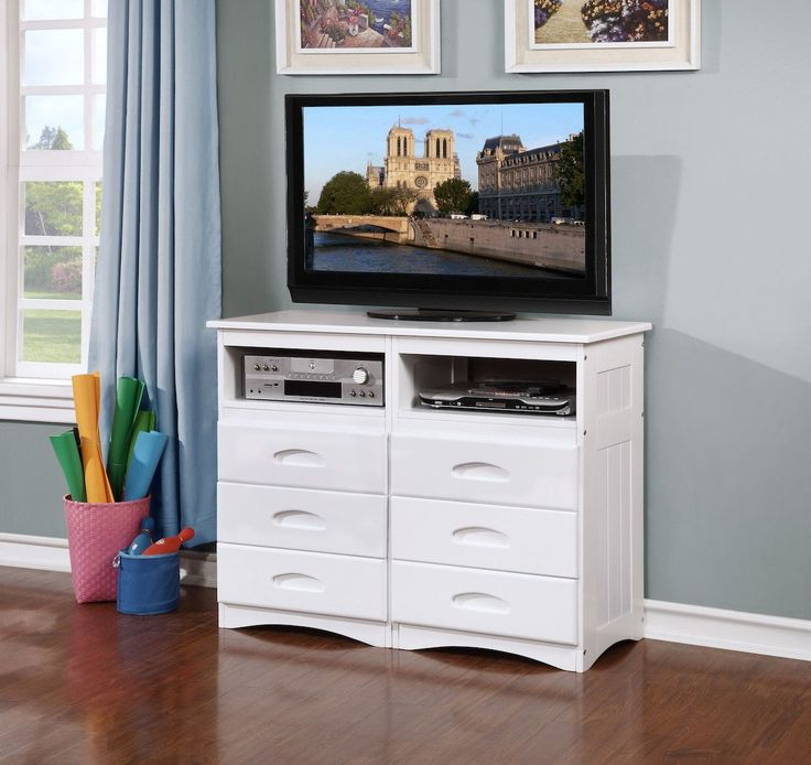 Our media dresser functions as both a dresser and a TV stand. With a classic white finish and constructed with solid pine, this piece is built to last. The dresser features two built in cubby-holes th