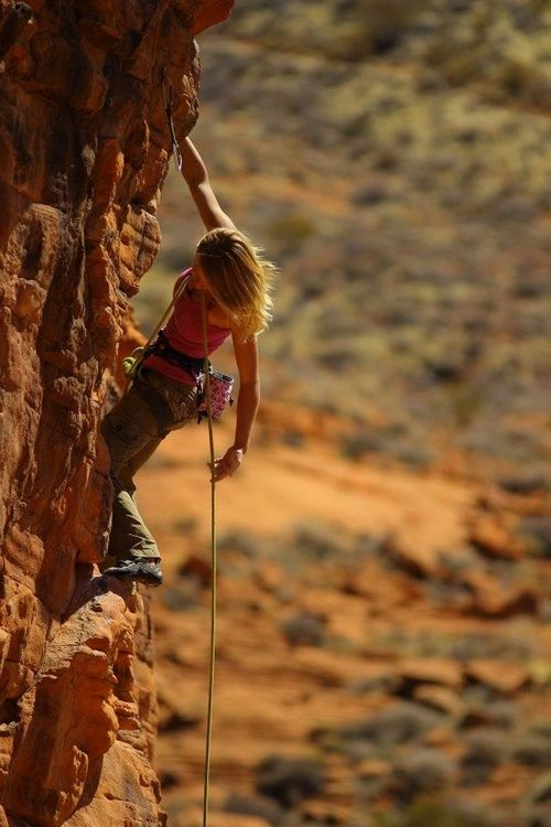 Rock climbing. This woman is a beautiful beast.