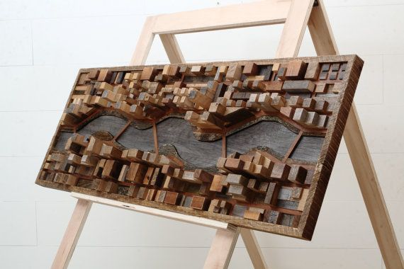 Wood wall art of a river cityscape made entirely by CarpenterCraig