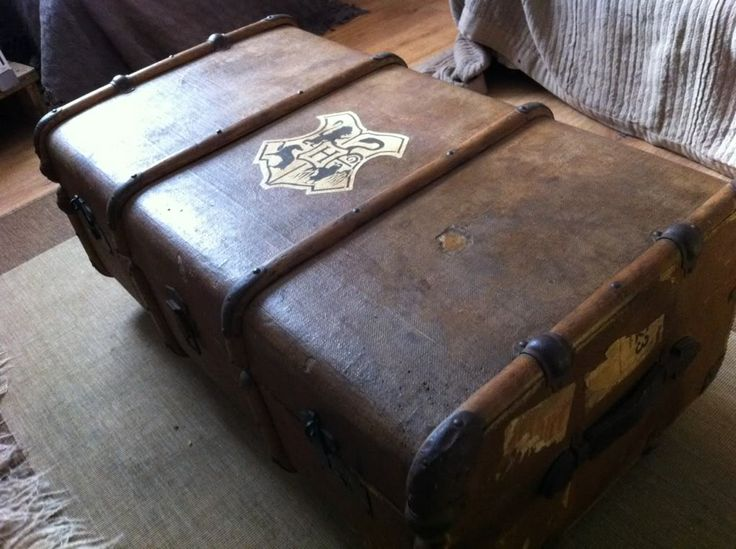 A Hogwart's emblazoned steamer trunk used as a coffee table. Nerd perfection.
