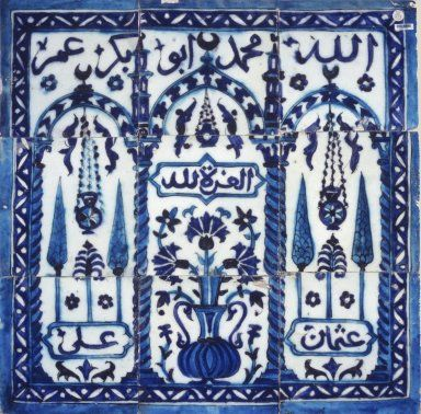 This tile panel recalls the garden-like setting of heaven described in the Qur'an. It depicts a triple-arched gateway—the gate to paradise—date palms, cypresses, mosque lamps, and a vase filled with carnations. The panel is inscribed with the names of God (Allah), the prophet Muhammad, and the four rashiddun. Medium: Ceramic; fritware, painted in cobalt blue and turquoise under a transparent glaze Place Made: Damascus, Middle East, Syria Dates: 17th century