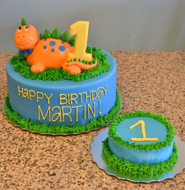 Adorable Dinosaur Birthday Cake from Sugarland in Raleigh and Chapel Hill with a matching smash cake