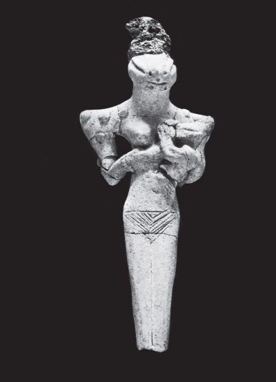 Глиняная статуэтка богини-матери с головой ящера-варана и ребенком на руках. Убейдская культура, Урук. 4000 г. до н. э.