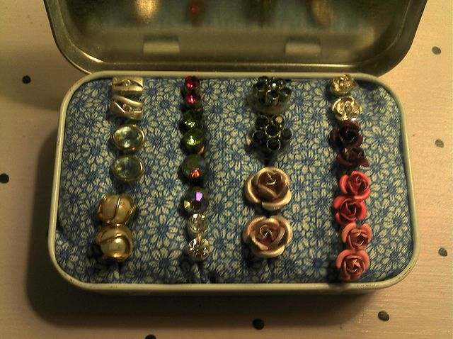 Altoid tin earring keeper! Would be so cute spray painted in a bright color and w/cute fabric!!