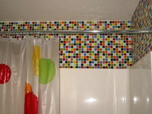 Add color tiles to revamp a boring bathroom without breaking the bank.  I'm thinking of doing black & pink, or black & cobalt blue for our 2nd bath.