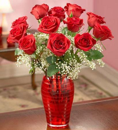 florero de rosas para mi madre..Maria Georginia..siempre estas en mi corazon..se que estas en esa estrella amada madre mia..escarcha..!!!